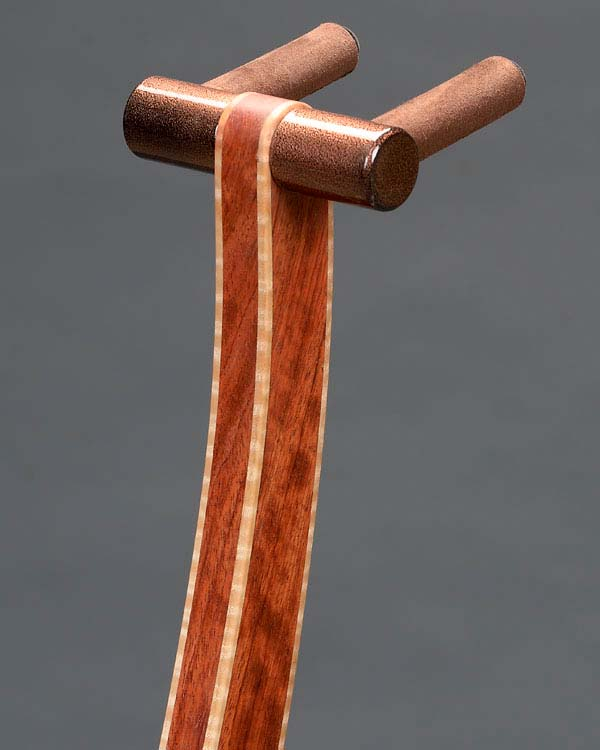 Bubinga with curly maple edge binding. Copper powdercoating.