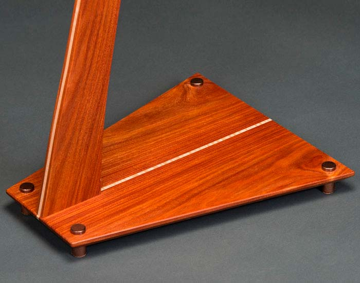 Santos mahogany SM guitar stand with curly maple inlay and copper powdercoated aluminum feet.