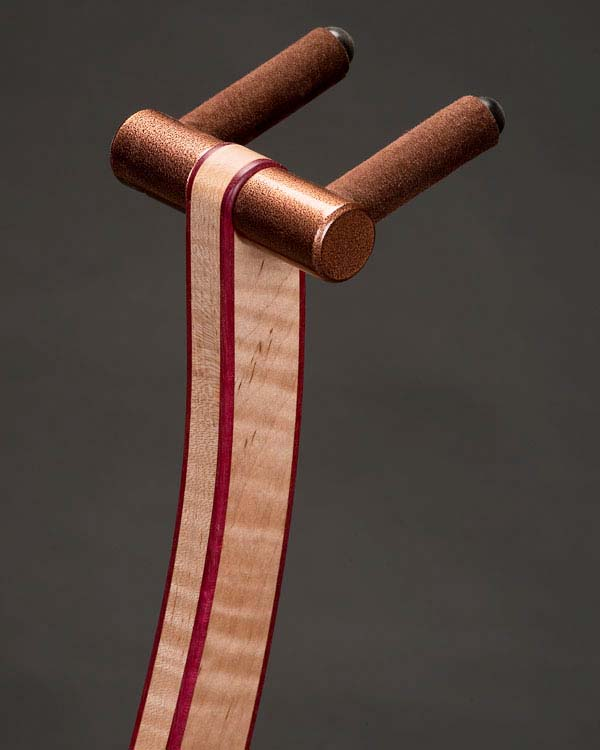 Curly maple with purpleheart edge binding. Copper powdercoating.